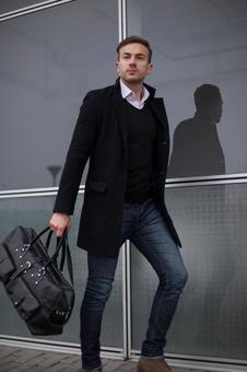 Male model 6 walking in front of the window
