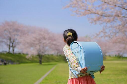 A girl carrying a school bag