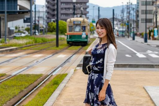A smiling woman walking in the town
