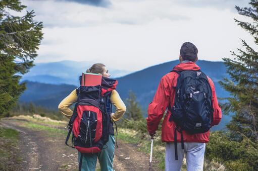 Trekker's couple walking on the mountain path 9