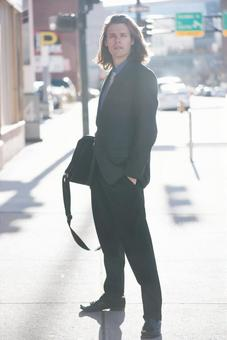 Foreign men with suit with a bag 4