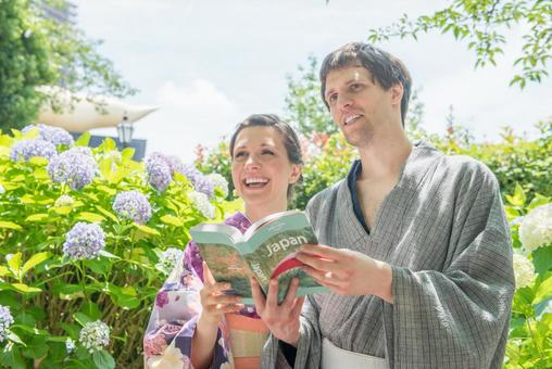 A guide book in front of hydrangea Yukata foreign tourist couple 2