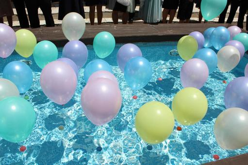 A colorful balloon floating on the water surface