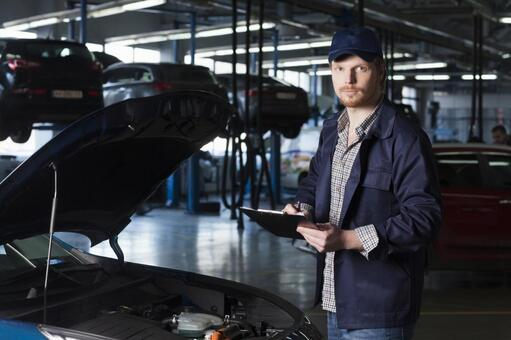 Automobile mechanic checking bonnet 11