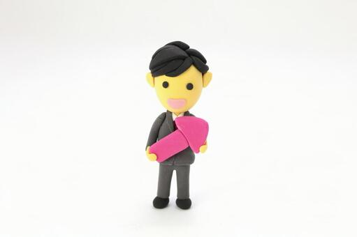 Clay art of an office worker with arrow 1