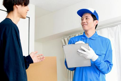 Image of conversation between a man wearing work clothes and a customer
