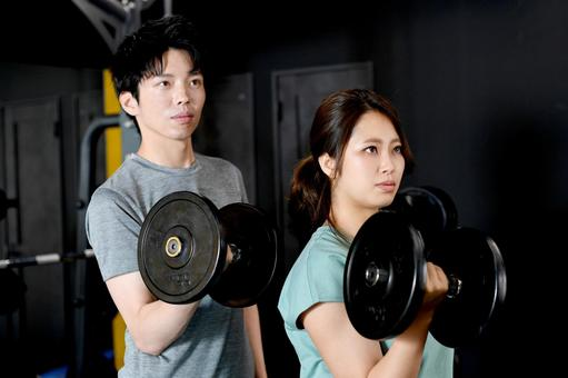 Men and women with dumbbells