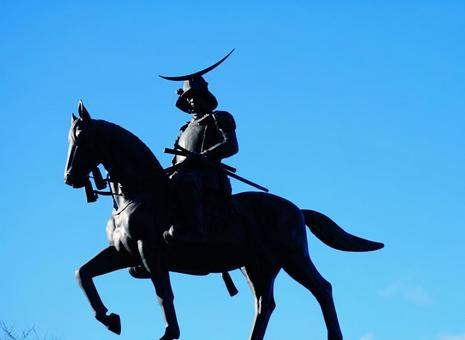 Statue of Masamune Date in the blue sky