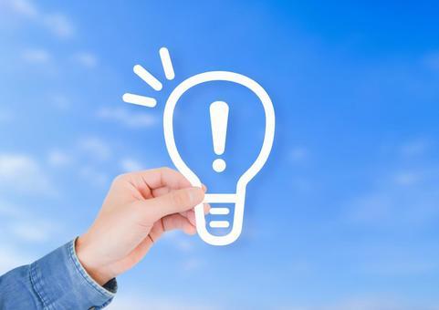 Hand with light bulb mark