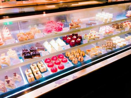 Cakes lined up in a shop window