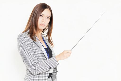 An angry-faced young businesswoman with a pointer