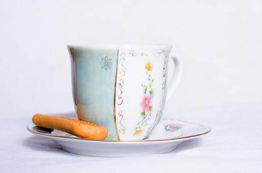 Cup and long biscuits
