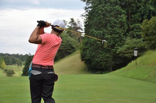 A man who plays a tee shot at golf