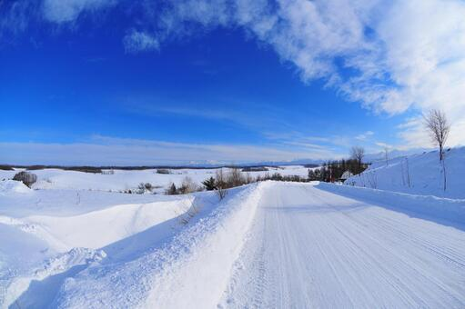 Snowy road and blue sky