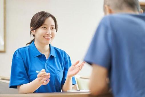 Caregiver explaining the facility to the elderly