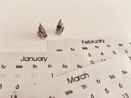 Wheelchair seniors and calendar