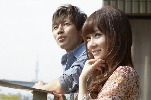 Couple standing on the veranda 3