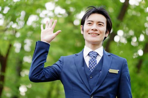 Hotel man raising his hand 2
