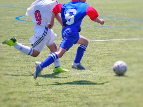 Soccer boy competing