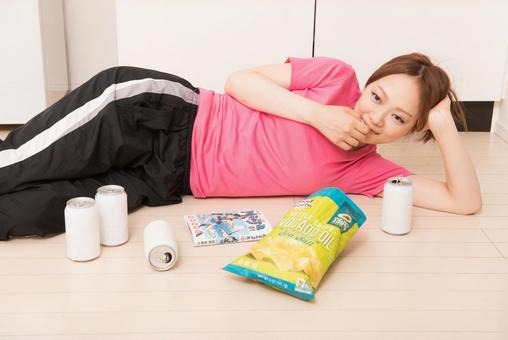 A lady who lies down and eats sweets
