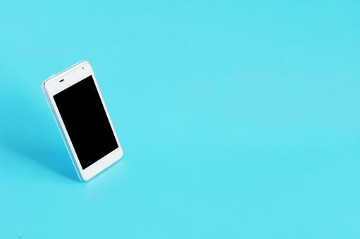 Smartphone placed on a light blue background