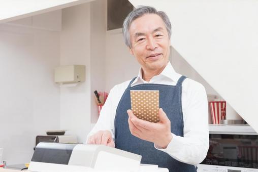 An old man hitting a cash register