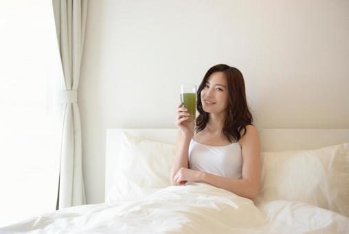 Female drinking in bed 18