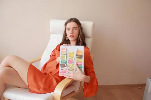 A woman sitting with a paper bag 1