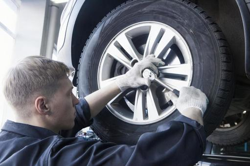 Automobile mechanic servicing tires 10