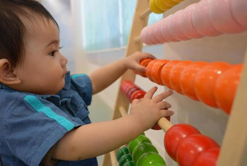 Baby playing with educational toys