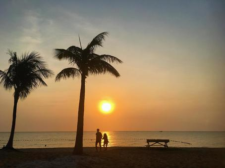 Couple at the beachside at sunset