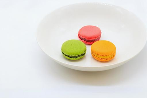 Three macaroons lined up on a plate