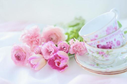 Tea cups and pink flowers