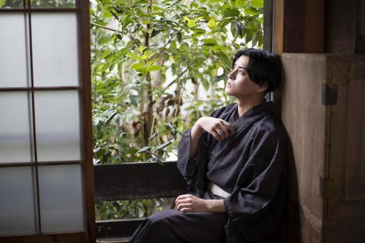Yukata man who feels the wind by the window