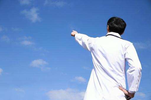 Doctor pointing to the sky