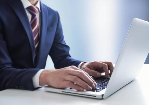 Businessman operating a PC