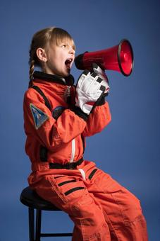 Girl 2 wearing a space suit and using a loudspeaker