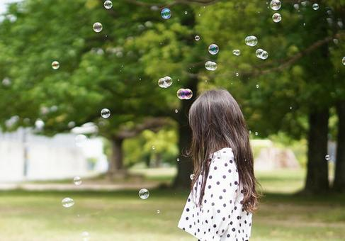 Soap bubble and girl