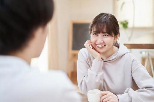 Asian men and women talking with a smile