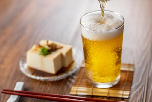 Glass beer and cold tofu