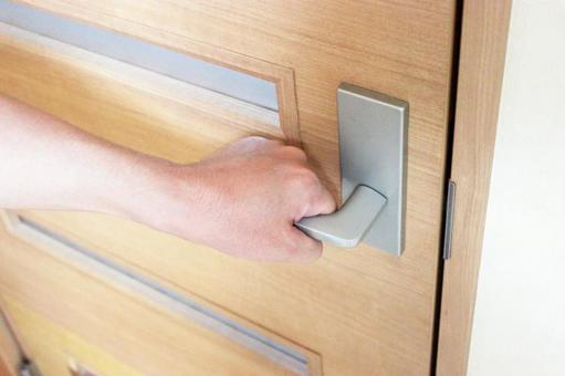 Hand to open the door