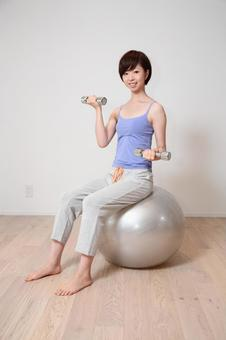 A woman holding a balance ball 14