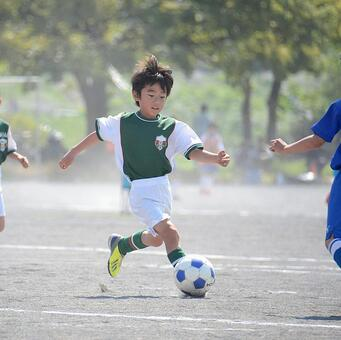 A boy playing football (after image quality correction)