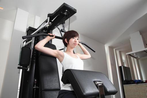 A woman using a training machine