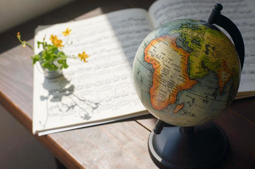 Sheet music and globe