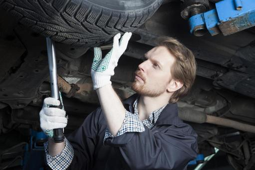 Automotive mechanic servicing tires 5