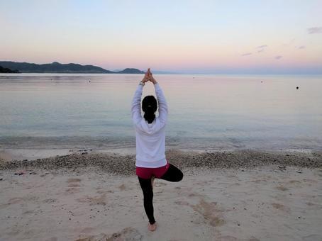 Morning yoga on the beach