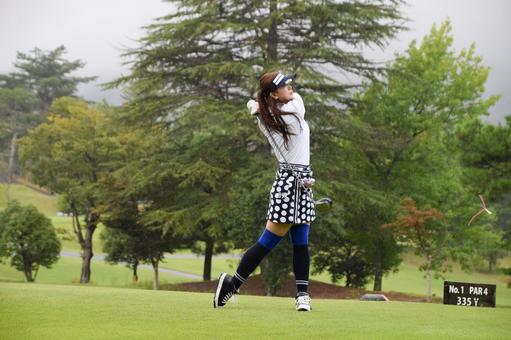 Golf girl 8 doing a driver shot