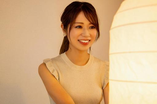 A woman smiling at the light of Bonbori
