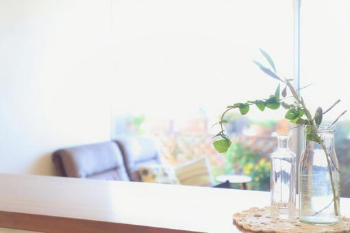 Image material of living room where bright sunlight is dazzling